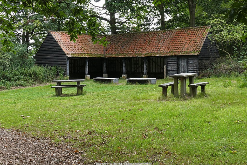 The former barn, black timbered and red roofed, in Little Wix Wood. Hatchlands Park (cc-by-sa/2.0 - © Alan Hunt - geograph.org.uk/p/4624626)